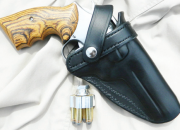 This holster from Holster Pro carries the author's favorite carrying .357 Magnum. (Note Ahrends grips.) The light weight speedloader is from Fice Star Firearms.