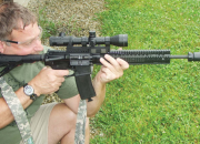 Author's best bud and shooting partner Frank runs the DDM4 LWV5 from a solid supported position testing the carbine's practical accuracy and eff effectiveness of the Surefire Mini.