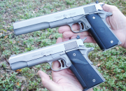 Introduced in 1977, the AMT Hardballer (held in left hand) was the first commercially-successful stainless-steel 1911 pistol. The impressive Long Slide Hardballer, with its 7-inch barrel, was introduced a few years later.