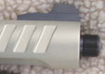 The muzzle of the 22/45 with the thread cap removed. Now you can attach a sound reducer where legal.