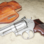 "The author's Model 66 ""River Gun"" and its DeSantis holster made for the perfect""traveling gun"" for use on river trips. Note the modified hammer and cylinderlatch as well as the rounding of all the gun's sharp edges."