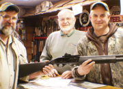 Left to right: author, with owners Miles and Darryl Spitler of Darryl's Gun Shop, with the FN SLP Standard 12 gauge prize gun