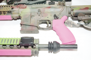 BLACKHAWK Offset Thumb Safety and Rail Mounted Thumb Rest with the neon green and pink LowPro Ladder and Slime Line rail covers with Ergo Grip in neon pink