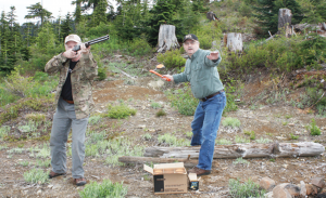 With Brian Lull at the ready, Workman gets ready to toss a clay target. Serious wingshooters should be doing this already in preparation for fall hunting.