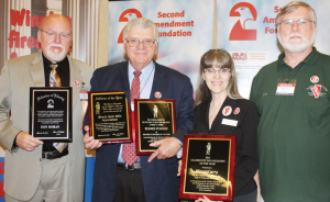Dramatic changes in Illinois gun carry laws were the focus for award presentations at the GRPC luncheon. Shown, left to right with their awards: Don Moran, president ISRA, with SAF Defender of Liberty Award; Richard Pearson, executive director ISRA, holds CCRKBA Affiliate of the Year Award given to Illinois State Rifle Association, and his personal CCRKBA Gun Rights Activist of the Year Award, and Valinda Rowe and husband, Mike, of Illinois Carry Inc., with CCRKBA Grassroots Organization of the Year Award.