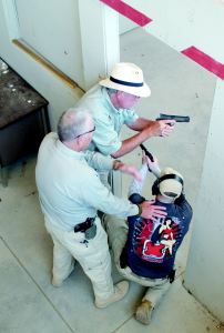 While the Custom line of Para aren't meant as defensive or combat handguns, they would certainly serve well. Here Chris Weare shows Galco's Mike Barham and me the proper way to clear a room.
