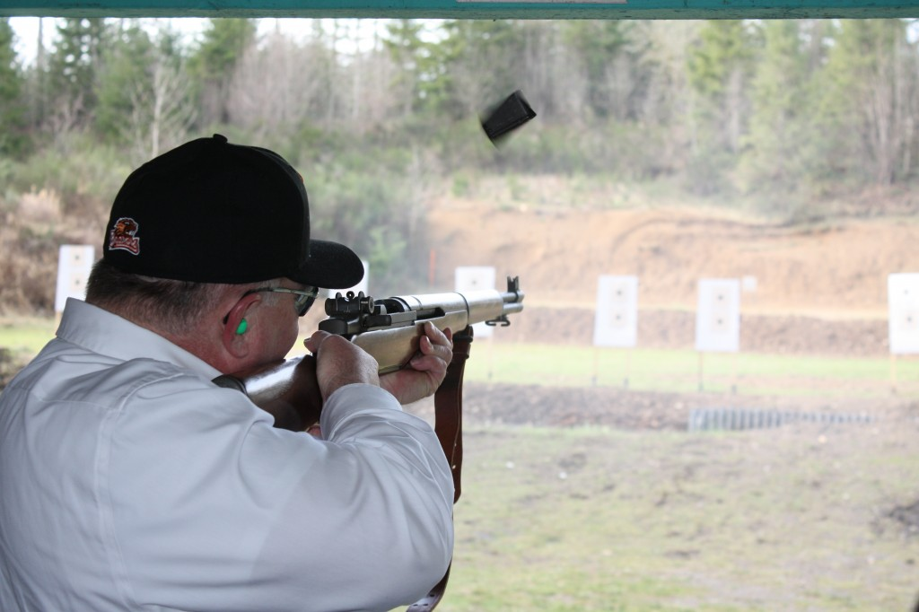 Sen. Jim Hargrove brought his M-1 Garand, shown here right after he touched off the last of eight shots. Notice the empty clip flying upwards out of the action.