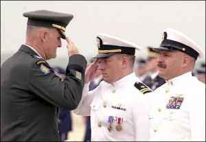 Nebraska Senate candidate Shane Osborn saluting after being awarded the Distinguished Flying Cross