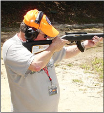 """Extended  ma gazines  ha v e become very popular since the magazine  restrictions  of  the """"Assault Weapons Ban"""" have been lifted.  Here, shooting companion Kirk Anderson shoots the 50th Anniversar y rifle with a  long extended magazine."""