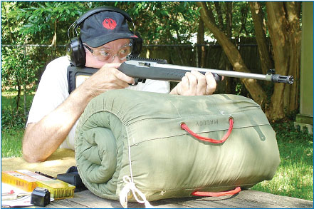 Accuracy shooting was done from the bench with a bedroll rest, Malloy's favorite shooting rest. This arrangement allows the rifle to be fired with a normal hold. Accuracy with all available ammunition was very good.