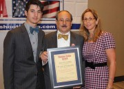After all the other awards were announced, Alan Gottlieb (shown here center with son Andrew and wife Julianne Versnel) was presented with a new Thomas Paine Award in recognition of his 40 years of leadership after founding the Second Amendment Foundation in 1974. The award was presented by Joe and Peggy Tartaro in the name of the Second Amendment Friendship, representing everyone attending the GRPC or supporting its common gun rights purposes. (Dave Workman photo)