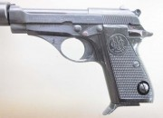 Except for the fake suppressor, it's a standard Beretta Model 71, with the slide latch, safety, and magazine release in the usual locations.