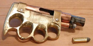 (Snappy Cappy Photos) This zip gun is an unusual design, brass knuckles with a pipe barrel sized for a .38 round.