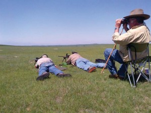 """The author (left) and Bob Sumner busting dogs """"out yonder"""" while Rick Miller spots."""