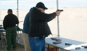The author firing the Colt Commander on the Range the day before the show.