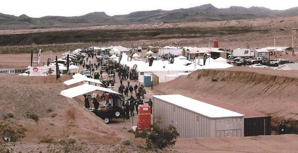 A view of the lower portion of Media/Industry Day that precedes the SHOT Show shown in operation at the huge Boulder City Gun Club. Some of the firing butts are to the left, others to the right and shotgun ranges were further up the hill behind this view.