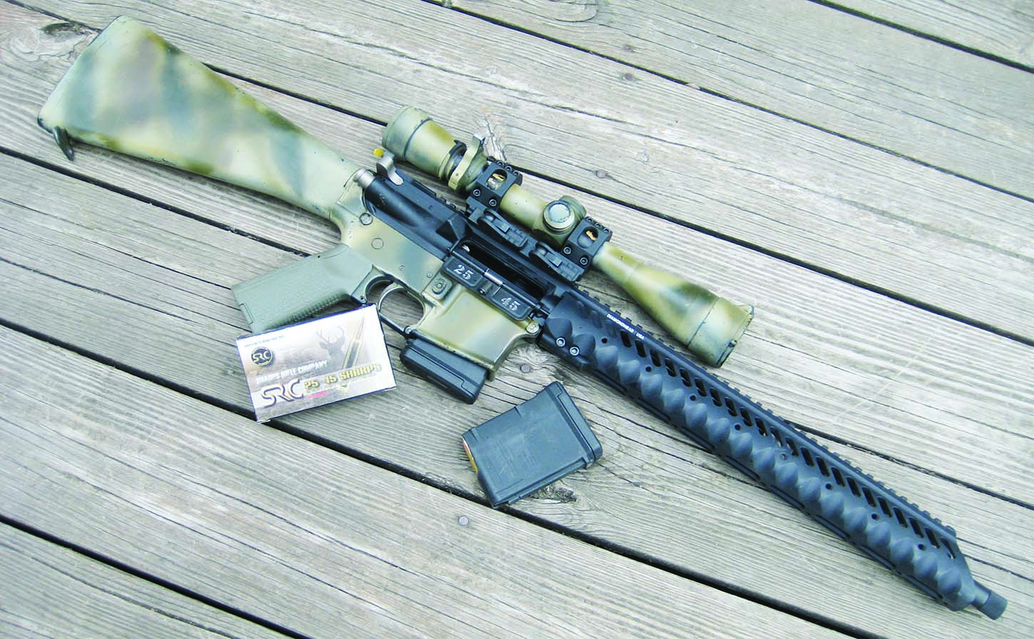 The SRC 25-45 upper receiver was tested on a Colt lower with a 4-14 Leupold telescope mounted in an American Defense QD mount. Note the clean, snag free lines of the Diamondhead USA free float forearm and screw-on muzzle cap.