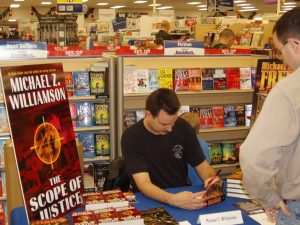 Michael Williamson at a book signing.