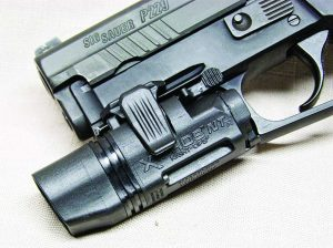 This Xiphos is mounted on a Sig P229 and you can see the easy access switch.