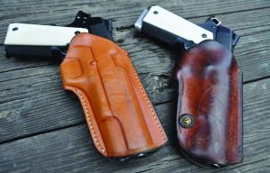 The author's original Thad Rybka Rhodesian holster (the one with the miles on it) and Erik Little's stellar new rendition: the #6 Selous Scout. Pure beauty and utility describe both rigs. Both holsters are for full sized 1911s.