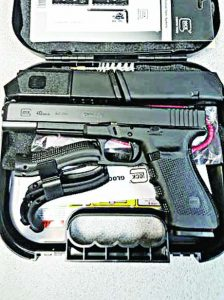 The Glock G41 MOS in its box with extra magazines, grip panels, cleaning rod and paperwork.