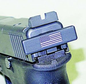 Close-up of the Tac Rack and after market rear sight with its wide notch.
