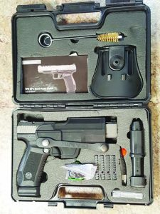 The Canik 9TPSFx with its lockable box, holster, red dot mounts and all the accessories.