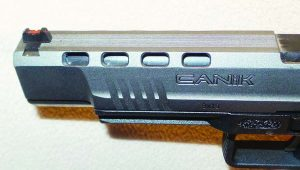 To reduce slide mass and felt recoil, Canik puts 10 cut outs in the slide, 2 are under the front of the slide; 4 on each side.