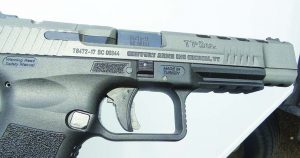 The right side view of the pistol shows the takedown lock and Picatinny rail.