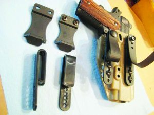 The SPEKTRE holster with the three different belt attachment systems.