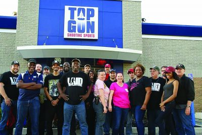 Between sessions in the free firearms safety mega-event on May 21, many of the volunteer instructors posed with students at the host Top Gun Shooting Sports range in Taylor, MI, which is rated as a Five Star range by the National Shooting Sports Foundation. (Photos by Patrick Dunbar.)