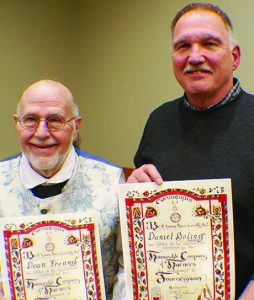 Left to right, Dean Freund and Daniel Boling with the Journeymen horner papers they received; next step is Master Horner.