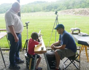 At a Table Shoot at the NMLRA range, left to right, Grandfather Don Blazier, Grandson Lucas Fulmer and Dad Curt Fulmer.
