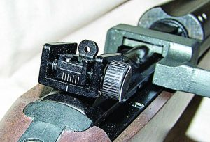 """The military style rear peep sight works well; I needed to set it on the """"300"""" setting to be accurate at 50 yards."""
