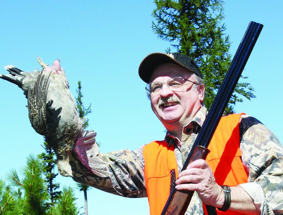 Author Workman with blue grouse and his favored Franchi 20-ga. over-under.