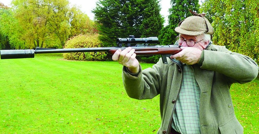"Famed white hunter and British ""Best Quality"" gunmaker Giles Whittome firing his original Maxim offset silencer on a Walther .22 specifically designed for use with a silencer. This .22 can be used as a semi-auto or a manually operated gun for maximum quietness, if desired."