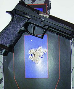 The P320 X5 proved to be accurate as this target shows; 22 rounds free style at 15 yards.