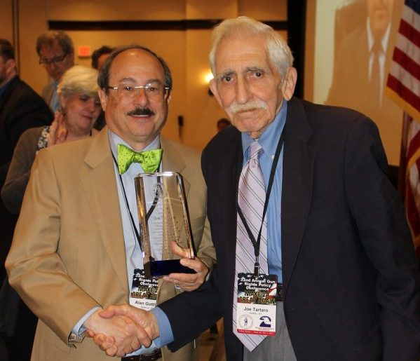 Alan Gottlieb presents TGM Executive Editor Joe Tartaro with a Lifetime Achievement Award. (Dave Workman)