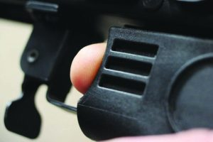 Close up shows how stock butts against trigger finger.
