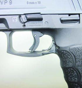 The left-side controls: Takedown latch, slide latch, magazine release.