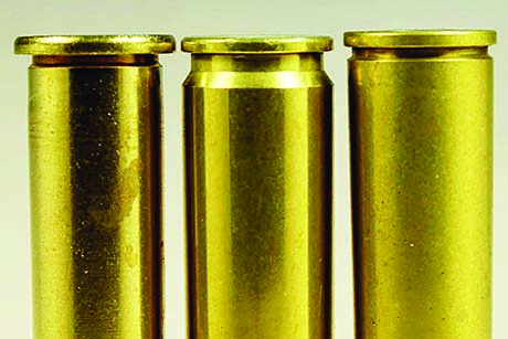 (L-R) Rimmed 30-30, rimless 260 Rem, semi-rimmed 6.5x50. The rim of semi-rimless cases extends only slightly wider than the case body; the 6.5x50 headspaces on the shoulder.