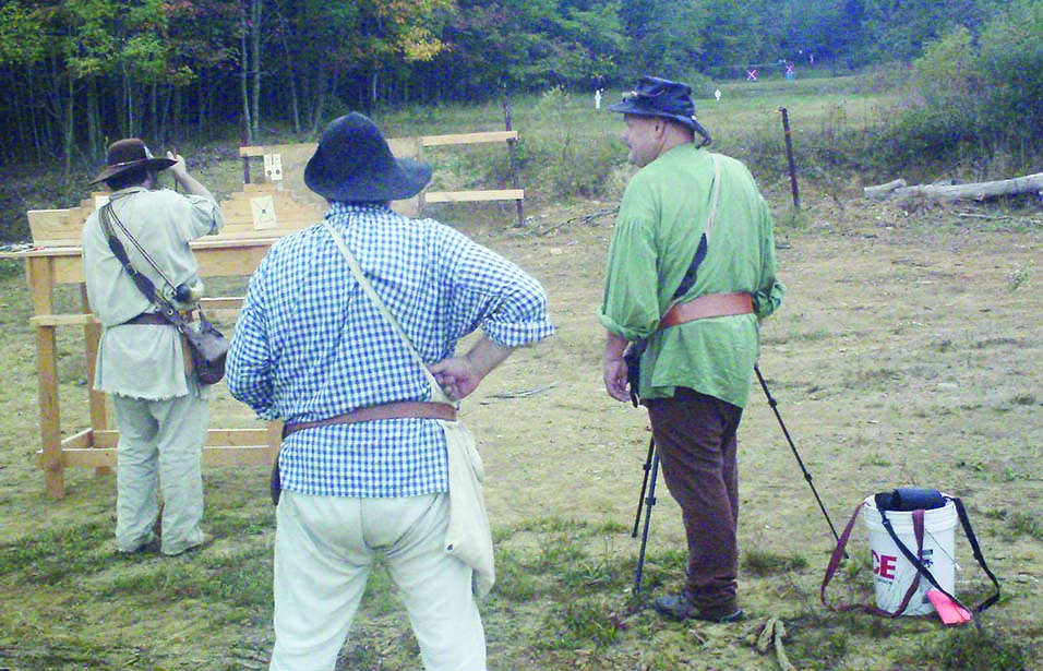 Left to right, Kurt Burket loading, Wes Griest scoring and Mike Wengert spotting. The long range targets at NMLRA Rifle Frolic can be seen in the background. Farthest shot is General Frazier then four targets for the Lt. Ephriam Brank match each getting closer.