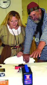Left, Past President NMLRA Becky Waterman picking a prize with author,