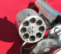Eight-chamber cylinder is relieved to allow for the use of full moon clips.