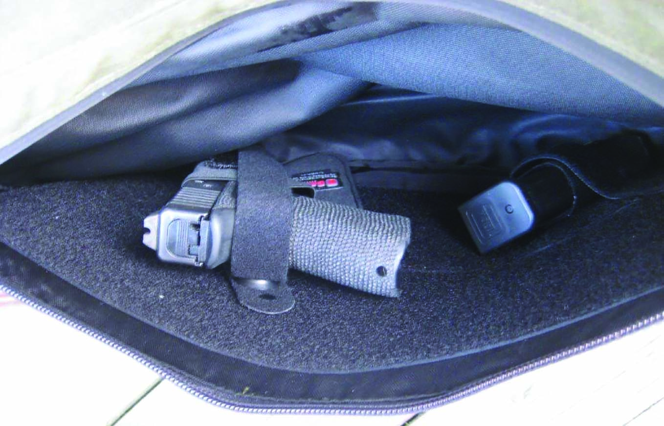The author's Overstreet Custom Glock 19 and a spare mag ride securely in the Galco briefcase insert holster set up.
