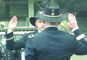 Author's oldest son Mark, facing camera, being sworn in as a Lieutenant Colonel in the United States Army at Pulaski monument in Washington, DC.