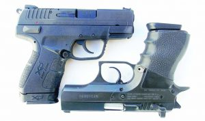 The XDE, left, compares well to traditional handguns such as the Baby Desert Eagle.