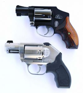 Compared to a five-shot .38 the six-shot Kimber .357, bottom, is little larger.