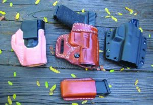 Three options for the carrying the Glock 19 from Galco. Left to right; The Scout 2 IWB in horsehide, the Avenger, and the Corvus Belt/IWB convertible in Kydex. Mag pouch is the Concealable.