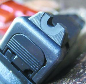 The Vickers Elite serrated rear sight from Wilson Combat allows for a fast sight picture and the tapered shape doesn't obscure a lot of one's target. It also has a forward ledge for one-handed slide racking.